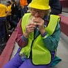 Community member Sheris Dojcsany takes a bite of one of the 2,017 tacos assembled by CSC Dining Services Friday, April 21, 2017, during an attempt to set the world's record for a taco line. (Photo by Tena L. Cook/Chadron State College)