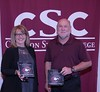 Dr. Barb Limbach, left, and Dr. Scott Ritzen, right pose with plaques honoring them for 30 years of service at the annual Chadron State College Faculty and Staff Recognition Luncheon Thursday, April 13, 2017, in the Student Center Ballroom. Not pictured, Max Franey. (Photo by Tena L. Cook/Chadron State College)