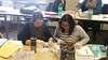 Students in Dr. Jesse Sealey's Teaching Elementary and Middle School Science (EDUC 422) course dissect owl pellets in a lesson taught by classmate Cali Crile. From left, Courtney Munger of Newcastle, Wyo. and Cara Sanchez of North Platte, Neb. The Chadron State College students identified the remains of several types of rodents including mice and moles, according to Sealey. (Courtesy photo)
