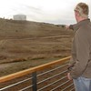 William Krause, a senior in the Chadron State rangeland management program, points out a plot of land near the new Rangeland Center where students are conducting experiments in control of smooth brome, an invasive grass species. The classroom building's location in an expanse of grassland gives students the opportunity for hands-on learning, said Krause. (George Ledbetter photo)
