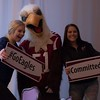 Prospective CSC students Kami Felker of Alliance, Neb., and Makayla Mckeehan of Falcon, Colo., pose with Elmo the Eagle during Signing Day, April 21, 2017, in the CSC Student Center. (Photo by Kelsey R. Brummels/Chadron State College)
