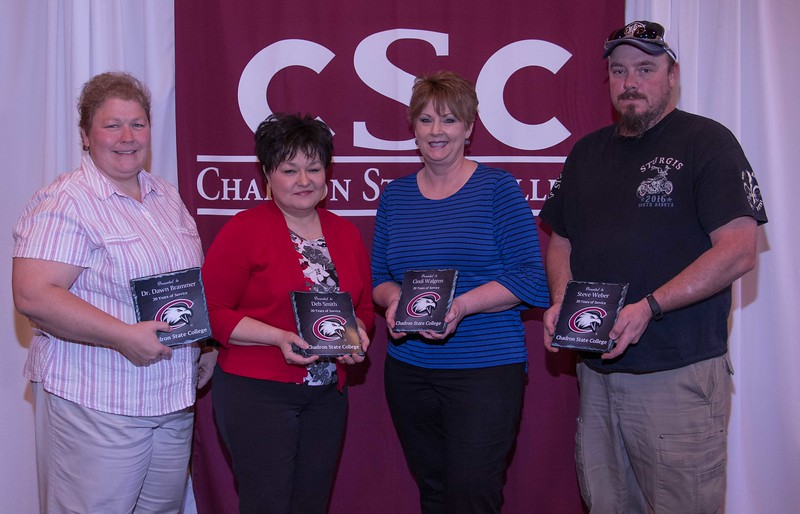 Employees honored for 20 years of service at the annual Chadron State College Faculty and Staff Recognition Luncheon Thursday, April 13, 2017, in the Student Center Ballroom. From left, Dr. Dawn Brammer, Deb Smith, Cindi Walgren and Steve Weber. (Photo by Tena L. Cook/Chadron State College)