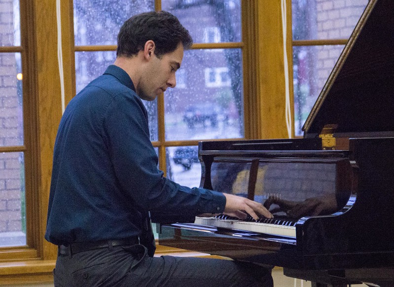 Music faculty member Brooks Hafey performs at the Piano Studio Recital Thursday, April 27, 2017, in the Sandoz Center Chicoine Atrium. (Photo by Tena L. Cook/Chadron State College)