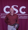 Dr. Tim Anderson poses with a plaque honoring him for 40 years of service at the annual Chadron State College Faculty and Staff Recognition Luncheon Thursday, April 13, 2017, in the Student Center Ballroom. (Photo by Tena L. Cook/Chadron State College)