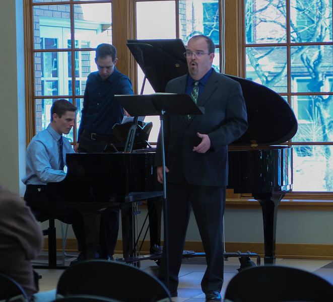 Chadron State College Music Professor Dr. Joel Schreuder, accompanied by Bobby Pace, performs a vocal piece during a music faculty recital in the Mari Sandoz Chicoine Atrium, Saturday, Feb. 17, 2018. (Photo by Kelsey R. Brummels/Chadron State College)