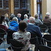 Audience members listen to Chadron State College Music Professor Dr. McKay Tebbs perform during a music faculty recital Saturday, Feb. 17, 2018, in the Mari Sandoz Chicoine Atrium. (Photo by Kelsey R. Brummels/Chadron State College)