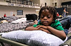 9-22-09  --red cross shelter 10--  Davion White, 6, rests on his cot at the Cobb County Civic Center on Tuesday afternoon.  White's family left their Lithia Springs apartment which they had only been living in for a month and have been staying at the emergency shelter since Monday night.  STAFF/LAURA MOON.