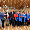 Members of the Mercy Auxiliary and Mercy staff join members of the Joplin Area Chamber of Commerce and W. Robert Corley (with scissors) for ribbon cutting ceremonies at the Mercy Gift Shop on Friday. The shop is run by about 50 volunteers and two part-time staff members.<br /> Globe | Laurie Sisk