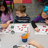 Globe/Roger Nomer<br /> (from left) Chloe Leow, Andrew Crabtree and Hailee Walker work with words during kindergarten on Thursday at Kelsey Norman Elementary.