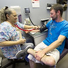 Community Clinic RMA Jane Fillmore checks Justin Toman's blood pressure on Wednesday at the clinic.<br /> Globe | Laurie Sisk