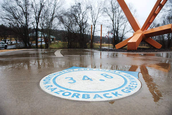 Globe/Roger Nomer<br /> A trailmarker marks the route along the Razorback Greenway Trail in Bentonville.