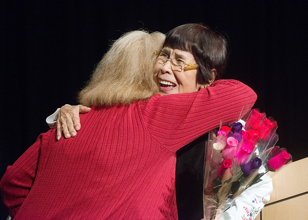 Globe/Roger Nomer<br /> Yoko Teats gets a hug from her daughter-in-law Paula following her presentation on Wednesday at Pittsburg State.