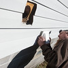 Globe/Roger Nomer<br /> David Perry installs an exaust vent for a ASHRAE fan on Wednesday at a home in Carthage.
