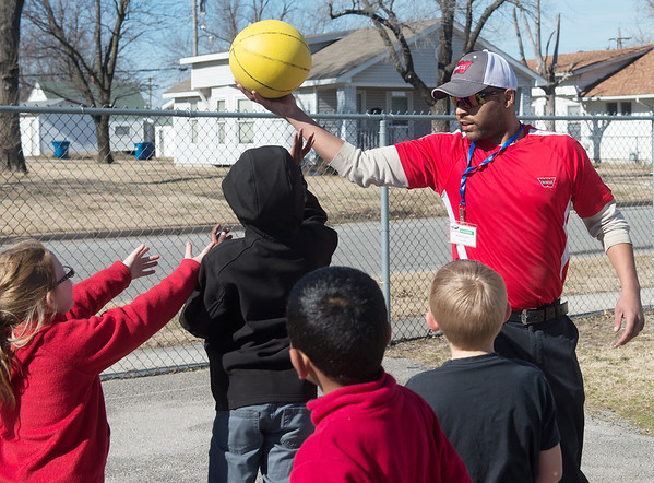 Globe/Roger Nomer Mark Fowler plays basketball with second graders after lunch on Wednesday, Feb. 1, at McKinley Elementary.