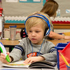 Globe/Roger Nomer<br /> Gabe Robertson uses an electronic reader during kindergarten on Thursday at Kelsey Norman Elementary.