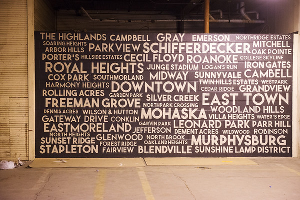 Globe/Roger Nomer A mural at the Empire Market contains the names of historic Joplin neighborhoods.