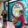 Globe/Roger Nomer<br /> Sue Hicks and Gibbs help Paula Baker, president and CEO of Freeman Health System, unveil a Window of Inspiration honoring therapy dogs on Tuesday in the walkway between Freeman Heart and Vascular Institute and Freeman Intensive Care Unit. Freeman Auxilary members sponsored two windows unveiled on Tuesday, this one and another one honoring Freeman Auxilary Volunteers.