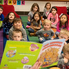 Globe/Roger Nomer<br /> Katie Hadley's class listens to her read a book during kindergarten on Thursday at Kelsey Norman Elementary.