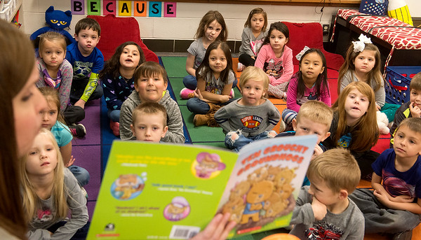 Globe/Roger Nomer Katie Hadley's class listens to her read a book during kindergarten on Thursday at Kelsey Norman Elementary.
