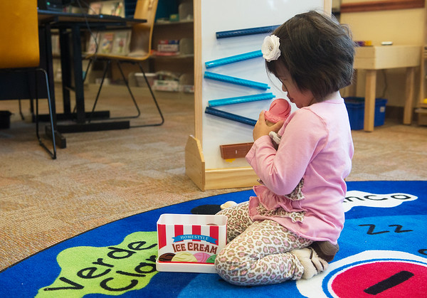 Globe/Roger Nomer<br /> Ela Terry, 4, Carthage, plays in the children's area of the Carthage Public Library on Friday.