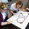 Globe/Roger Nomer<br /> Aubree Morris, a sophomore from Webb City, left, and Toria Carver, junior, work on a poster on Friday during the Foreign Language Field Day at Joplin High School.