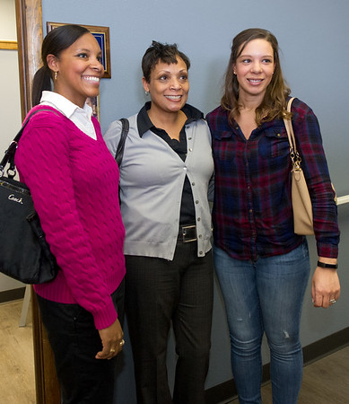 From the left: Adrienne Carson, Jodi Evans and Maegan Burr stand beside a plaque honoring Joplin healthcare pioneer and Community Clinic founding board member Doris Carson on Friday at the clinic. Evans is Carson's granddaughter and Carson and Burr are Carson's granddaughters.<br /> Globe | Laurie Sisk