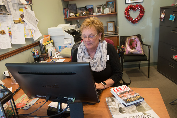 Globe/Roger Nomer<br /> Julie Yockey, director of the Carthage Public Library, works in her office on Friday.