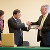 Globe/Roger Nomer<br /> Shandong Foreign Trade Vocational College President Yang Mingang and Cui Wei, director of international programs at Shandong, give Missouri Southern President Alan Marble to gift of a plate depicting Qingdao, China, on Friday at MSSU.