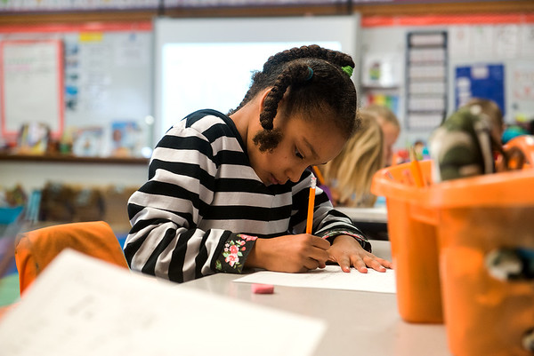 Globe/Roger Nomer<br /> Adwem Barstow works on a writing project during kindergarten on Thursday at Kelsey Norman Elementary.