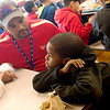 Globe/Roger Nomer<br /> Mark Fowler eats lunch with lunch buddy Davion Polk, second grade, on Wednesday, Feb. 1, at McKinley Elementary.