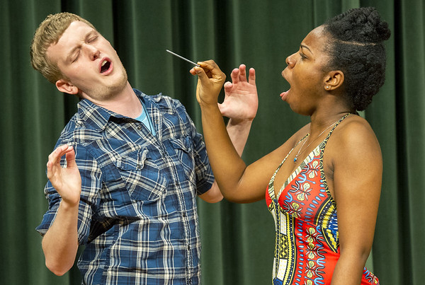 Missouri Southern senior Esther Henry, right, reacts on Friday afternoon after pulling a large nail from the nose of MSSU junior Nate Huff during rehearsal for the Black Student Union Talent Show, which was Friday night at Corley Auditorium. The talent show wrapped up a week of events celebrating National Black Student Union Spirit Week.<br /> Globe | Laurie Sisk