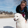 Globe/Roger Nomer<br /> Kendall Chenault pets Whisk before a run on Tuesday at the Frisco Trail.