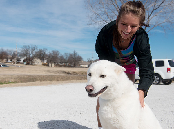 Globe/Roger Nomer Kendall Chenault pets Whisk before a run on Tuesday at the Frisco Trail.