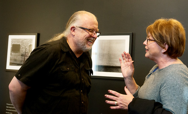 Globe/Roger Nomer<br /> Orjan Henriksson talks with Lori East, Carthage, during a reception at Missouri Southern's Spiva Gallery on Monday.