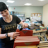 Globe/Roger Nomer<br /> Darcy B. Wood, circulation manager at the Carthage Public Library, processes books on Friday at the Library.