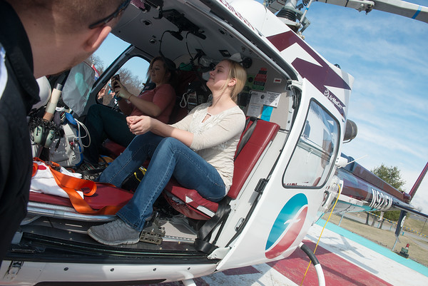 Globe/Roger Nomer<br /> Ashley Hobson, East Newton, checks out the interior of the medical helicopter on Tuesday at Freeman Health Systems.