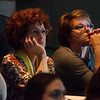Globe/Roger Nomer<br /> Brenda Sageng, adjunct professor at Missouri Southern, left, and Lori East, Carthage, watch an emotional slideshow of Orjan Henriksson's work from Auschwitz during a presentation on Monday at MSSU.