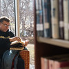 Globe/Roger Nomer<br /> Don Smith reads on Friday at the Carthage Public Library.