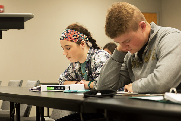 Globe/Roger Nomer<br /> Destiny Evans, an Ozark Christian College sophomore from Bartlett, Kan., leads prayer to open class on Thursday at the College. Also pictured is Kirk Mitchell, a junior from Albuquerque, N.M.