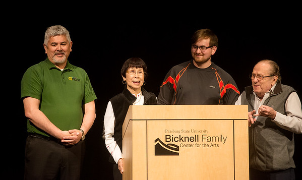 Globe/Roger Nomer<br /> Yoko Teats, accompanied by (from left) son James, grandson Jacob and Bob Herrmann, talks about her experience in Japan during WWII on Wednesday at Pittsburg State.