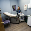 Community Clinic Executive Director Stephanie Brady moves equipment in one of the newly remodeled exam rooms at the clinic on Wednesday.<br /> Globe | Laurie Sisk
