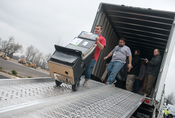 Globe/Roger Nomer<br /> Slot machines are unloaded at Kansas Crossing Casino on Tuesday, Feb. 28.