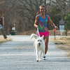 Globe/Roger Nomer<br /> Kendall Chenault runs with Whisk on Tuesday on the Frisco Trail.