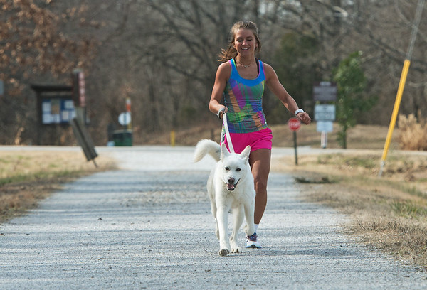Globe/Roger Nomer Kendall Chenault runs with Whisk on Tuesday on the Frisco Trail.