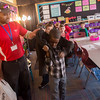 Globe/Roger Nomer<br /> Mark Fowler helps lunch buddy Davion Polk, second grade, with his coat on Wednesday, Feb. 1, at McKinley Elementary.