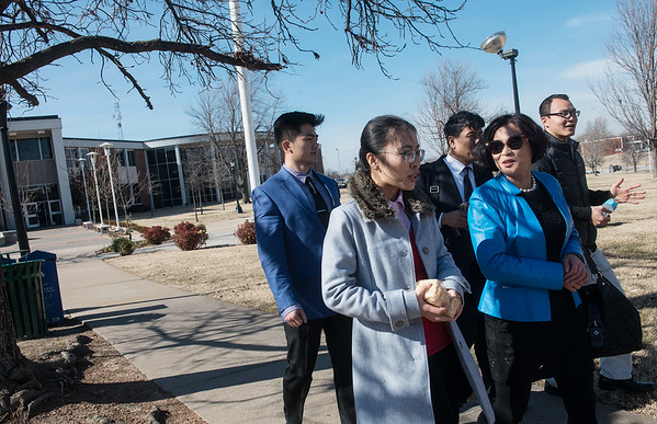 Globe/Roger Nomer Lisa Li, a Missouri Southern masters student from Linyi, China, talks with Chen Li, dean of finance and accounting at Shandong Foreign Trade Vocational College, as they walk on campus at MSSU on Friday. Lisa Li is carrying treats brought by the Chinese delegation givne to the MSSU students.