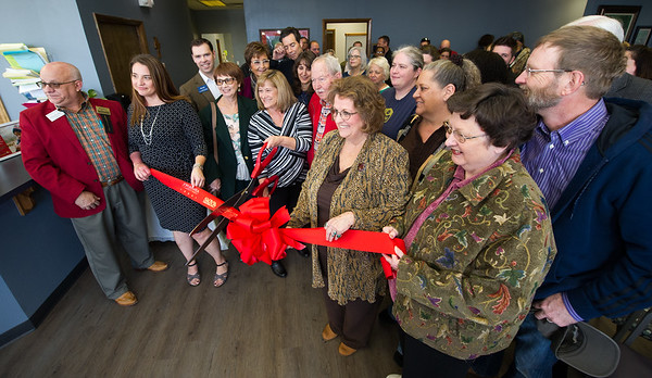 Community Clinic staff, members of the Joplin Area Chamber of Commerce and members of the community gather for a ribbon cutting for the recently remodeled clinic on Friday.<br /> Globe | Laurie Sisk