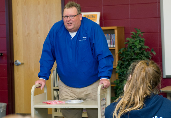 Scott Narrell, catastrophe claims adjuster, gives students an inside look into his profession during Career Day on Thursday at South Middle School. About 25 presenters talked about their professions during the day-long event.<br /> Globe | Laurie Sisk