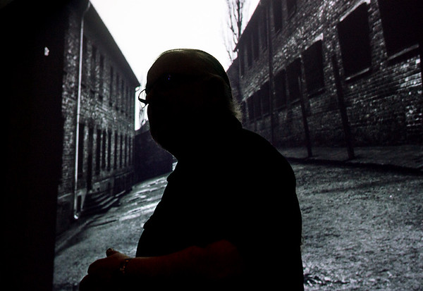 Globe/Roger Nomer<br /> Orjan Henriksson is silhouetted against his photo of Auschwitz during a talk on Monday at Missouri Southern.