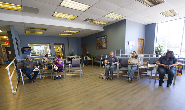 Clients wait in the newly remodeled lobby of the Community Clinic on Wednesday.<br /> Globe | Laurie Sisk